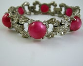Art Deco Pot Metal Bracelet with Deep Pink Moonglow Thermoset Cabochons and Rhinestones