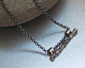 Fine silver pendant on an oxidized silver chain
