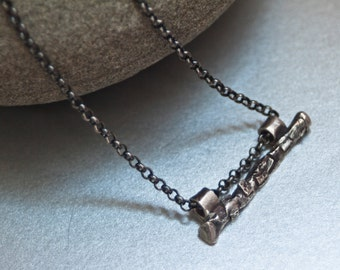 Fine silver pendant on an oxidized silver chain