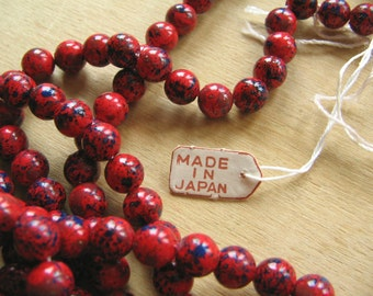 A Hank of Vintage Made in Japan Red and Navy Paint Splatter Beads - Beads Stranded Hank - Red Beads - Blue Beads - Vintage Beads