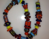 Handmade Glass Beads - 15 inches of fun shapes!