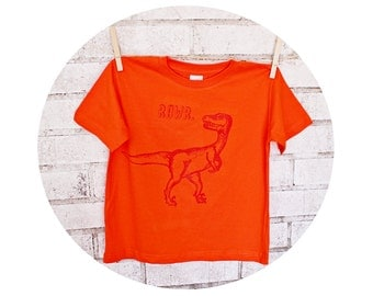 "Dinosaur Children Or Toddlers tee shirt, Raptor ""RAWR,"" Cotton crew neck tshirt in Orange, T Shirt, Hand Printed, Prehistoric animal"