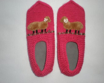 Hand-knitted women pink slippers with sheep