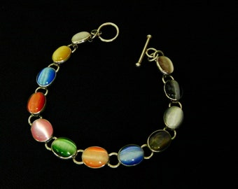 Fiber Optic Cabochon Bracelet in Sterling Silver. Multi Color Cat's Eye Glass Stones.