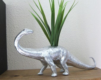 Silver dinosaur ornament statue figurines with plant