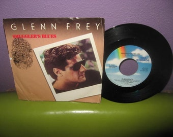 "HOLIDAY SALE Vinyl Record Glenn Frey - Smuggler's Blues 7"" 45 RPM 1985 Single Rock Miami Vice"