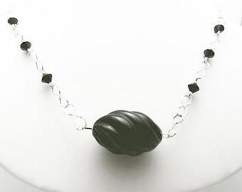 Jet Black Focal Bead on a Handmade Necklace with Swarovski Crystls