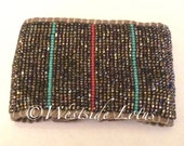 Fortunate direction. Wide beaded loomed leather cuff.