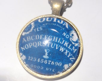 OUIJA board necklace pendant one inch round on antiqued brass 18 in chain  Blue board