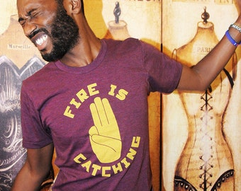 3 Finger Salute.  Tri-Blend Unisex/Men American Apparel sizes small, extra large, and 2xl.