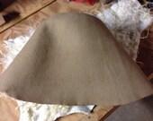 Wool felt cone hood hat body is made from 100% merino wool fiber for hat blocking .