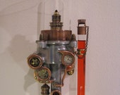 Wall mounted oil lamp made with recycled metals and glass. Steampunk industrial.