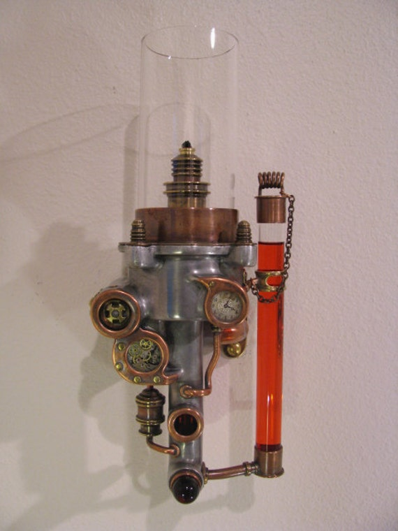 Wall mounted oil lamp made with recycled metals and glass.