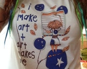"t-shirt saying ""i make art and art makes me"" by rachel awes."