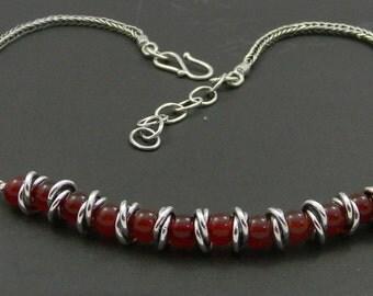 Handwoven chain with carnelian beads