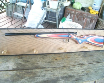 Rustic Wooden Coat Rack with Red, White, and Blue Rifle Great for Christmas