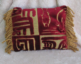 Red velvet Asian style pillow with gold and twisted gold fringe