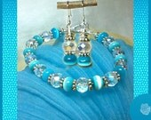 "7.5"" Bracelet Turquoise Blue Catseye Rondels Czech Crystal AB Rondels Pewter Daisy Spacers And/Or Matching Earrings Sterling Silver EarHooks"