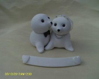 Seal bride and groom wedding cake topper