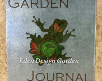 Blank garden journal-sketchbook with cork cover and etched metal plate featuring frog and leaves