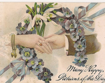 Victorian Postcard - Clasped Hands with Snowdrops and Primroses - Hearts - Blue Ribbons - Purple Flowers