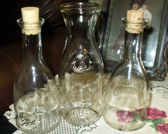 Three Cruets Decanters Clear Glass Storage Jars Two with Corks Vintage