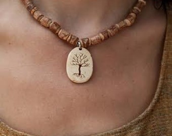 Hand carved Tree pendant on bamboo/tulsi necklace ;)
