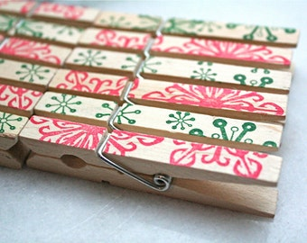 Decorative holiday clothespins, set of 24 - red and green snowflake, hand stamped pattern.  Holiday display, rustic decoration.