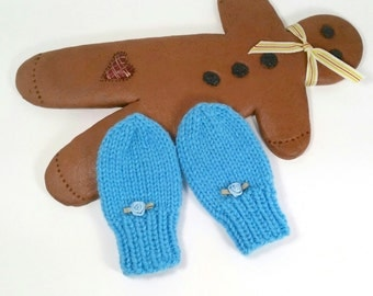 Tiny Knitted Mittens for Babies. Newborn size. Thumb-less. Blue color with little rosettes.