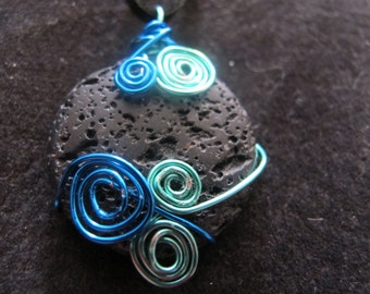 Wire wrapped lava stone pendant necklace with turquoise and blue spirals and swirls