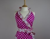 Retro apron crossed over, white polka dots on a pink fabric. 1950s inspired, fully lined.