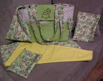 Delightful Handmade Monkey Diaper bag complete with changing pad, wipes cover and wet bag.