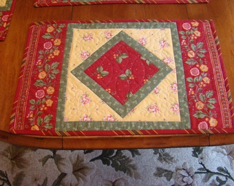 Oversized set of four placemats.  Brick red, yellow and green make up these placemats with a cherry theme.