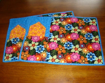 Set of four quilted floral placemats.  A pocket holds the napkin and even the silverware.