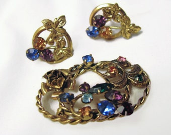 Azub Austria demi parure. Beautiful bronzy tone 2 inch wide brooch with sparkling prongset cabachons. matching screw on earrings.