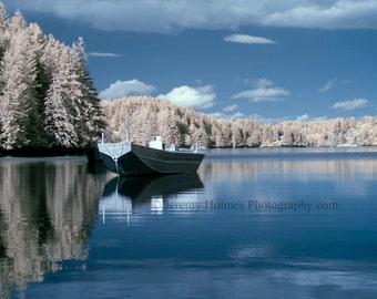 Alaska Kodiak island, calm seas and a fishing boat make for a relaxing spot to enjoy the view