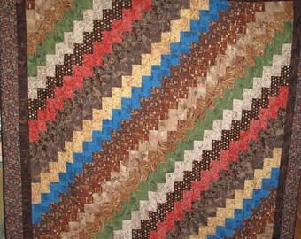 Lap Qult Made of Australian Fabrics in a Bargello Design