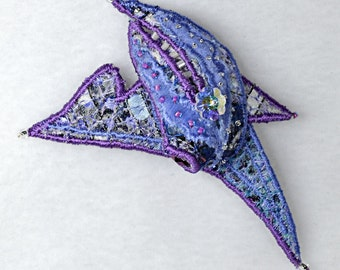 Textile brooch in blue and purple