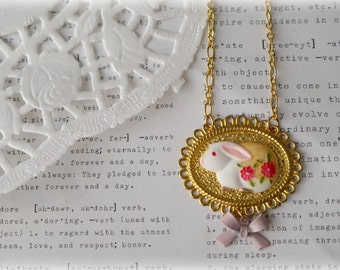 Floral Bunny in Gold Lace Frame with Pink Bow Necklace