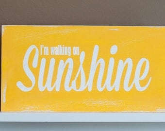 I'm walking on sunshine sign