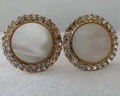 Earrings clip mother of pearl discs encircled by rhinestones