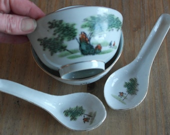 pair of antique fine china chiness soup dishes and spoons