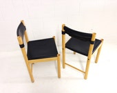 mid century modern chairs made in Italy by Ibisco with black thick leather seats set of two