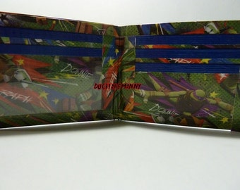 hand made duct tape wallet with the TMNT all over it