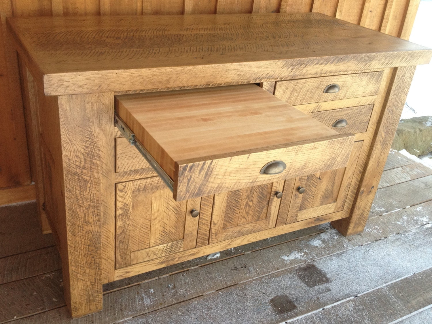 aged oak kitchen island with sliding butcher block