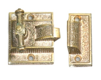 Set of three ornate window latches