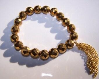 Sparkly Glitzy Faceted Gold Titanium Hemitite Bracelet with gold chain Tassel