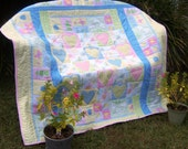 Pastel Animals & Applique Hearts w/ blue fleece back approximately 50 in. square