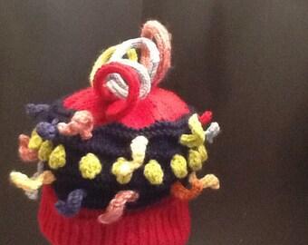 Hand knit child's hat.