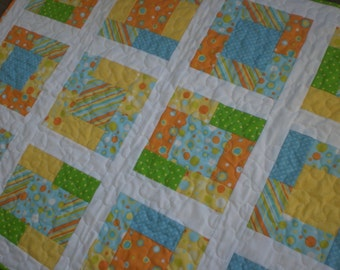 Baby quilt in blue, green, orange and yellow